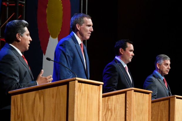 From left to right, Republican candidates for Colorado Governor Greg Lopez, Doug Robinson, Walker Stapleton and Victor Mitchell during the GOP debate at Davis Auditorium at Sturm Hall on the Denver University campus June 16, 2018.