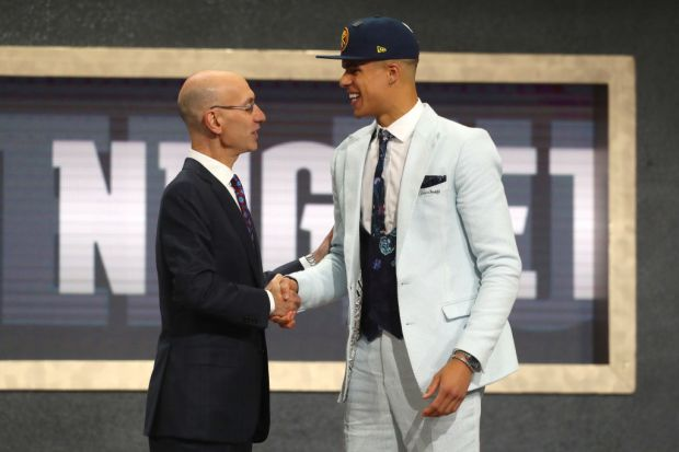 Michael Porter Jr. poses with NBA Commissioner Adam Silver after being drafted 14th overall by the Denver Nuggets during the 2018 NBA Draft at the Barclays Center on June 21, 2018 in the Brooklyn borough of New York City.