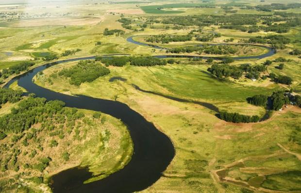 The Rio Grande River snakes along ...