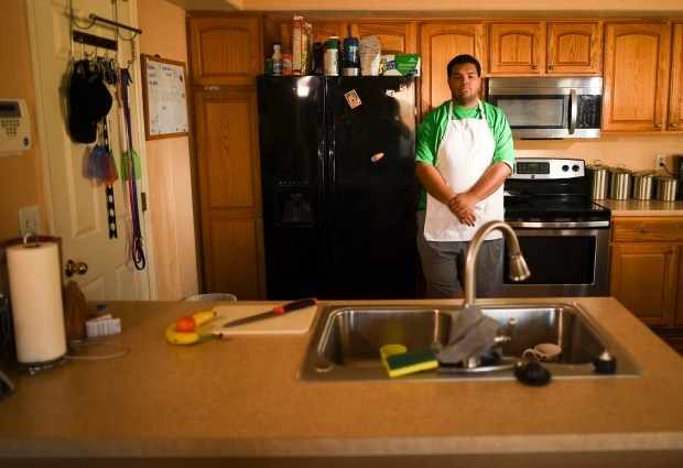 DENVER, CO - MARCH 12: Travion Shinault has always had a love for cooking and food. His grandfather runs a food truck and Travion grew up helping him cook barbecue. Despite getting bariatric surgery Travion plans to enroll in culinary school this coming fall. (Photo by RJ Sangosti/The Denver Post)