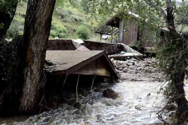 A home heavily damaged by the 2013 flood in Boulder County's Fourmile Canyon, where an upcoming creek restoration project will include federal dollars to be used toward the removal of old mine tailings.