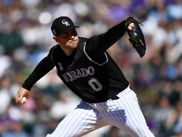 Colorado Rockies relief pitcher Adam Ottavino pitching against the San Diego Diego Padres in the eighth inning at Coors Field on April 25, 2018.