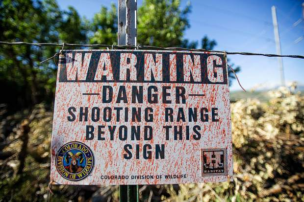 The Basalt Shooting Range sign covered in slurry from drops on the Lake Christine Fire.