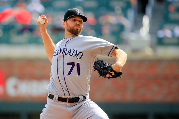 Wade Davis (71) of the Colorado Rockies pitches during the ninth inning against the Atlanta Braves at SunTrust Park on August 19, 2018 in Atlanta, Georgia.