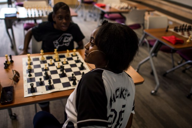 Brownie Wright, 19, plays a game against ReaAsia Hollins, 15, during a Make a Chess Move tournament on August 1, 2018 in Mental Health Center of Denver in Denver, Co. Make a Chess Move is a small, non-profit based in Northeast Denver that teaches teenagers how to make decisions in life and measure consequences through the game of chess.