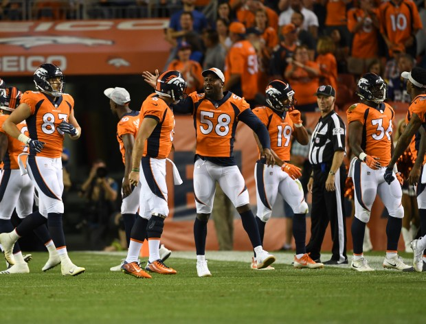 Von Miller comes off the sideline to celebrate a 36-yard touchdown pass from Chad Kelly #6 as the Denver Broncos take on the Minnesota Vikings during the first preseason game at Broncos Stadium at Mile High on Aug. 11, 2018 in Denver.