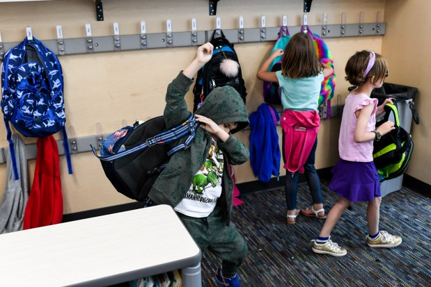 Max Martinez puts his backpack on at the end of the day at Sierra Elementary on Wednesday, August 22, 2018.