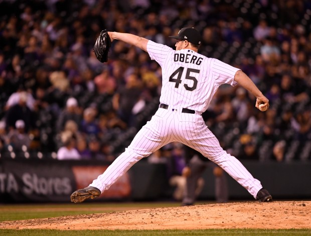 Colorado Rockies relief pitcher Scott Oberg winds up for a pitch against the San Diego Padres in the eighth inning at Coors Field April 10, 2018.