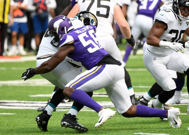 Minnesota linebacker Antwione Williams (56) picks ...