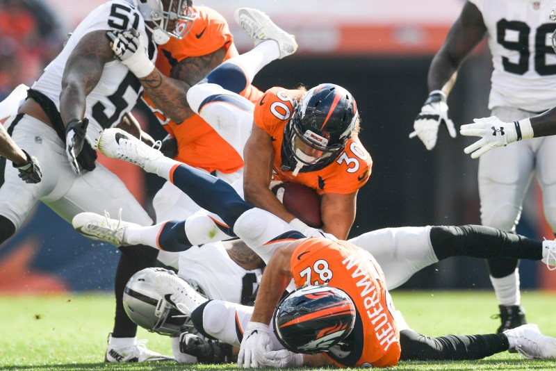 Phillip Lindsay (30) of the Denver Broncos is tackled against the Oakland Raiders during the third quarter on Sunday, September 16, 2017. The Denver Broncos hosted the Oakland Raiders.