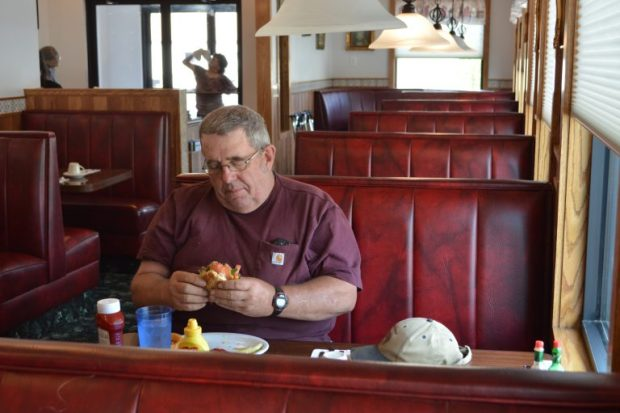 Jim Reeve, of LaSalle, enjoys a cheeseburger for lunch Thursday at the Country Inn, 1415 8th Ave., Greeley. The Country Inn reopened this past month more than two and a half years after a fire shut the restaurant down.