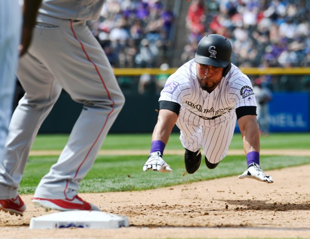 Colorado Rockies right fielder Noel Cuevas ...