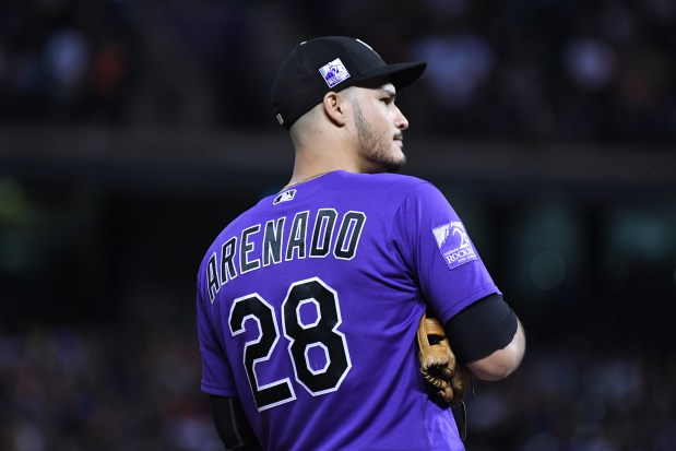 Colorado Rockies Nolan Arenado is watching ...