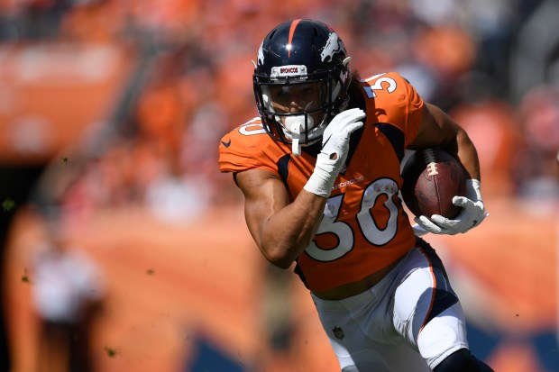 Phillip Lindsay (30) of the Denver ...