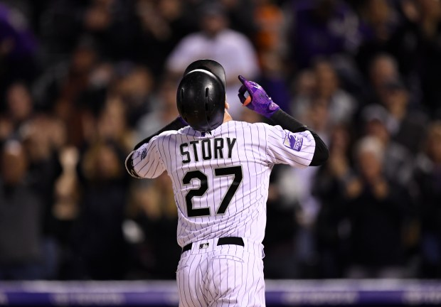 Colorado Rockies shortstop Trevor Story points to the sky after hitting another solo home run against the San Francisco Giants in the fourth inning at Coors Field Sept. 5, 2018.