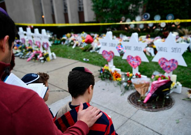 People pay their respects at a memorial outside the Tree of Life synagogue after a shooting there left 11 people dead in the Squirrel Hill neighborhood of Pittsburgh, Pennsylvania on Oct. 29, 2018.