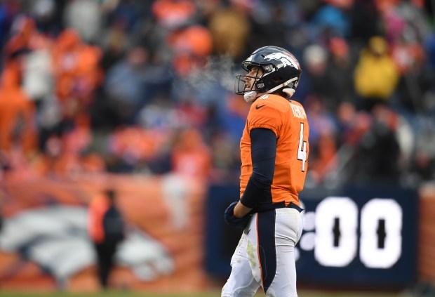 Denver Broncos Case Keenum #4 walks ...