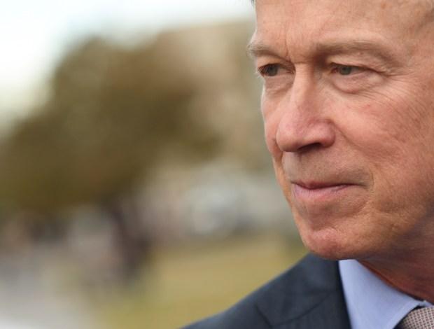 Colorado Gov. John Hickenlooper talks to ...