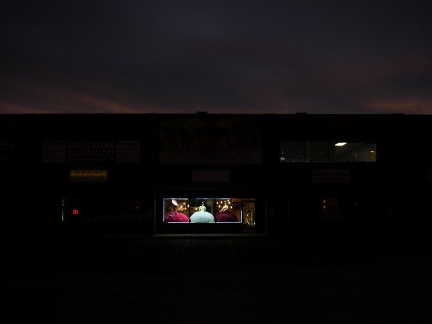 A store window is lit up ...