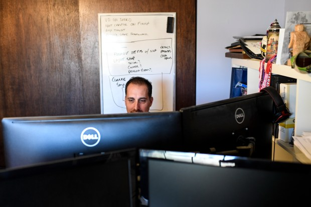 CEO of One Room Games Isaac Herman works at his home office on Friday