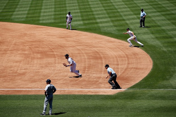 The Colorado Rockies infield employ the ...