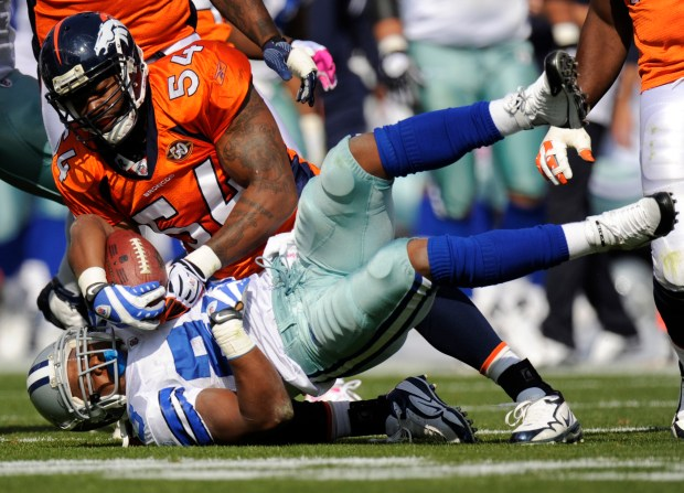 Denver Broncos defender Andra Davis pulls ...