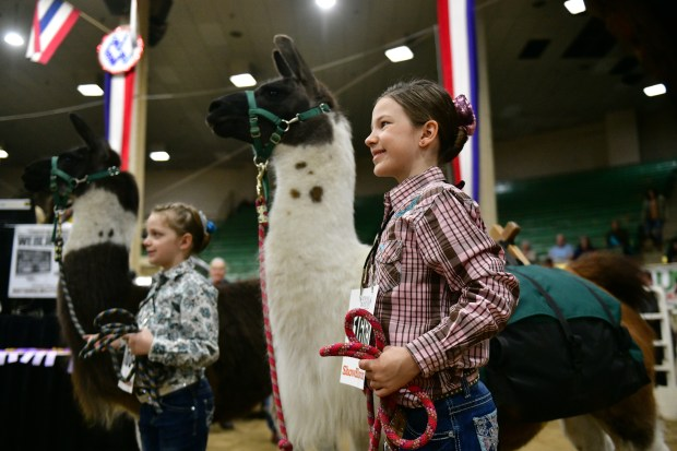 Lilly Cline, 9, of Littleton, right, ...