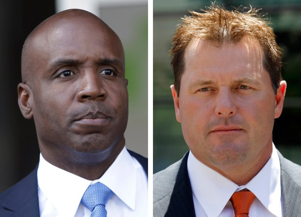 At left, in a June 23, 2011, file photo, former San Francisco Giants baseball player Barry Bonds leaves federal court in San Francisco. At right, in a July 14, 2011 file photo, former Major League baseball pitcher Roger Clemens leaves federal court in Washington.