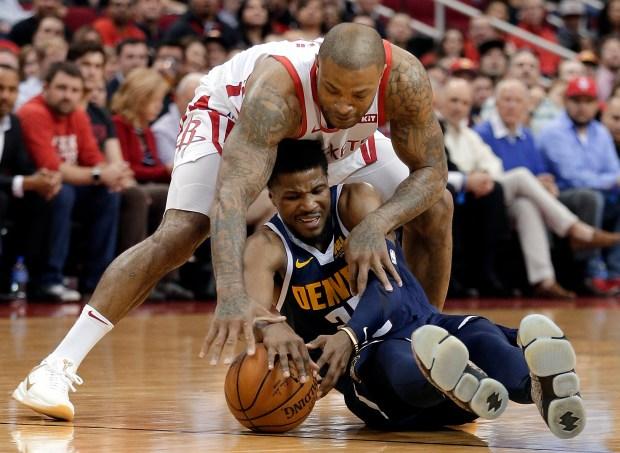 Denver Nuggets guard Malik Beasley, bottom, ...