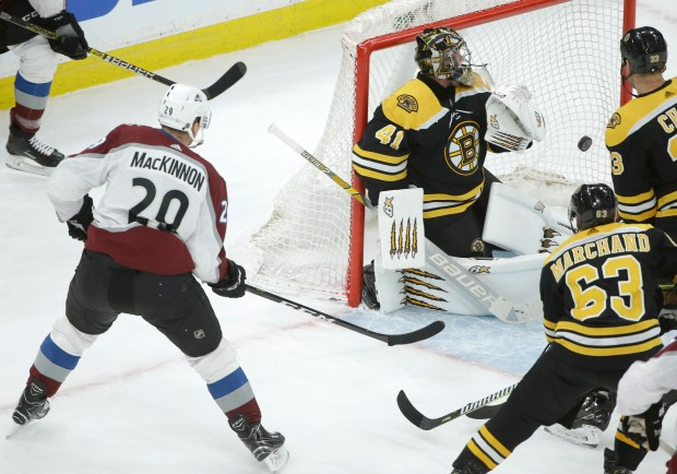 Colorado Avalanche's Nathan MacKinnon (29), left, ...