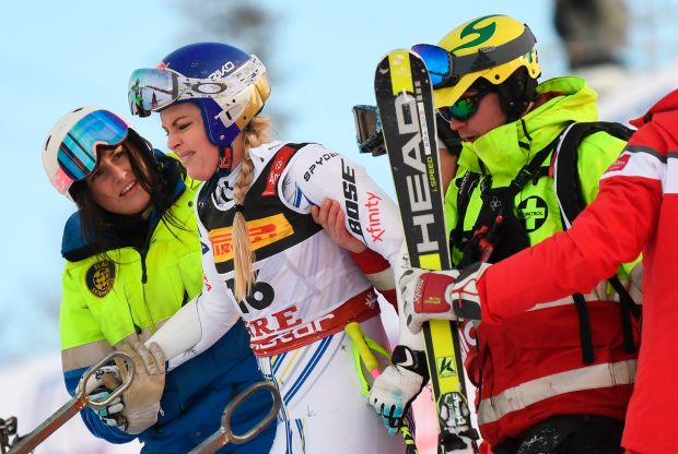 Lindsey Vonn, second from the left, of the US gets help after she crashed during the women's Super G event of the 2019 FIS Alpine Ski World Championships at the National Arena in Are, Sweden, on Feb. 5, 2019.