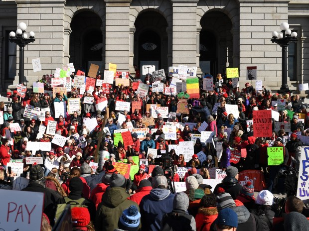 Educator and supporters rally outside the ...