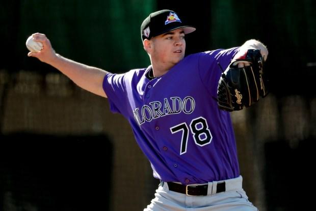Colorado Rockies pitcher Peter Lambert throws ...