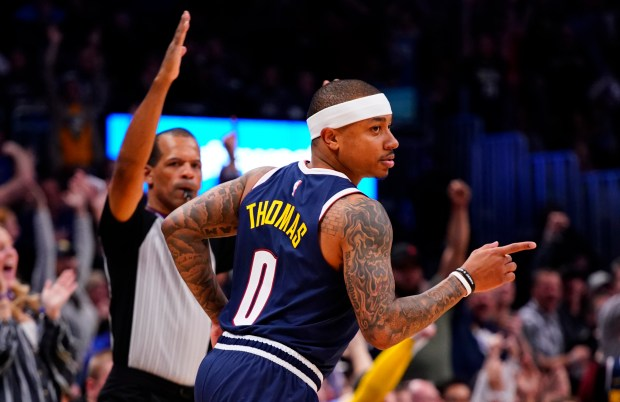 Denver Nuggets guard Isaiah Thomas celebrates a 3-point shot against the Sacramento Kings during the second half of an NBA basketball game Thursday, Feb. 13, 2019, in Denver.
