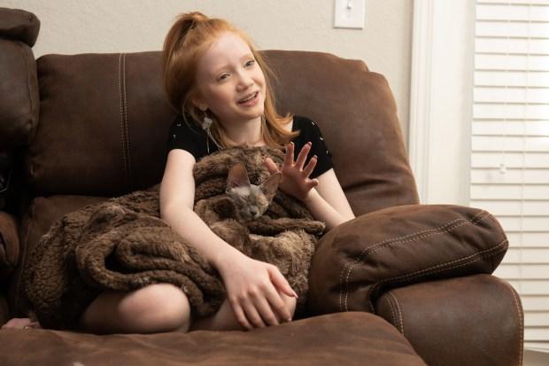 Makenna Kelly, 13, holds her Sphynx ...