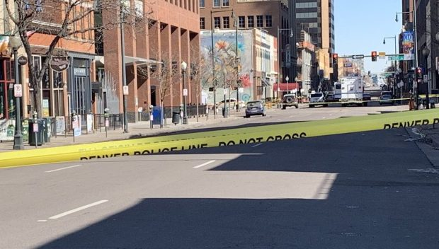 Police tape blocks off Market Street from 14th to 16th streets for an investigation into an early-morning shooting that left one dead and three injured on March 10, 2019.