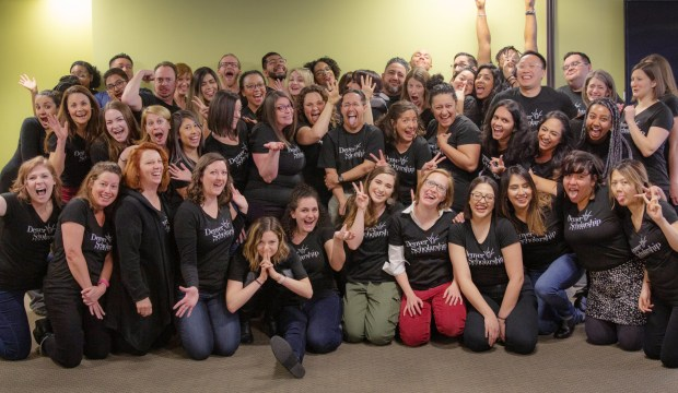 Staff members at Denver Scholarship Foundation pose together for a photograph.