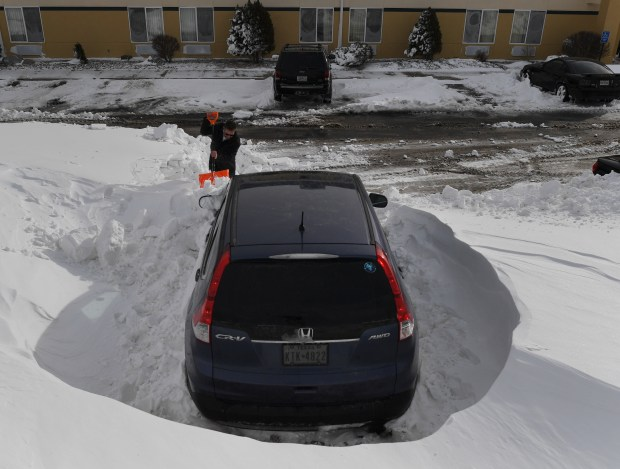 Matt Hermanson finishes up digging out, ...