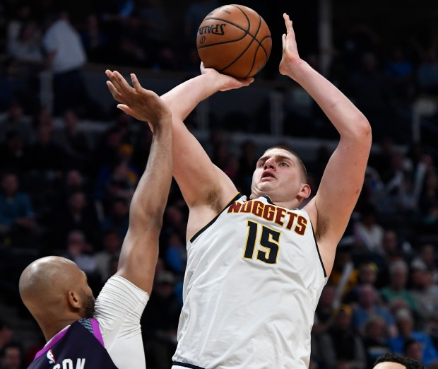 Denver Nuggets center Nikola Jokic (15) ...
