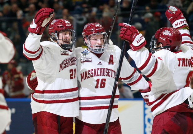 Massachusetts' Mitchell Chaffee (21) and Cale ...