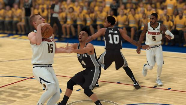 Nuggets center Nikola Jokic drives on Spurs guard Derrick White in NBA 2K19.