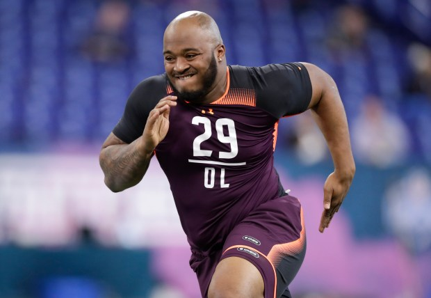 In this March 1, 2019, file photo, Mississippi State offensive lineman Elgton Jenkins runs a drill at the NFL football scouting combine in Indianapolis.