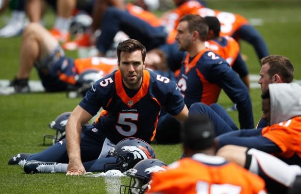 Denver Broncos quarterback Joe Flacco takes ...