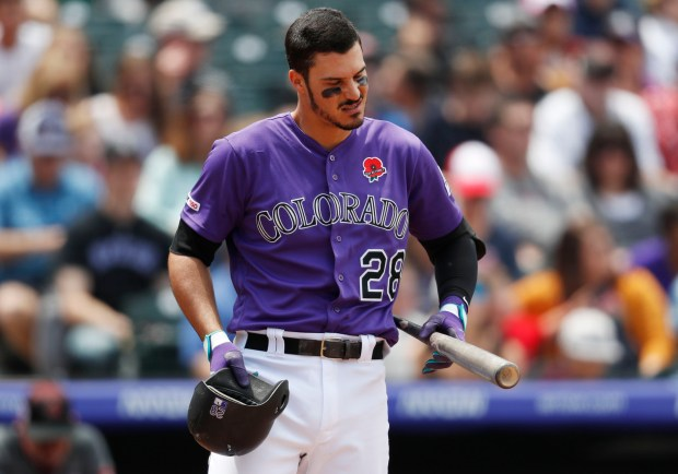 Colorado Rockies' Nolan Arenado checks his ...