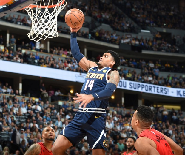 Denver Nuggets guard Gary Harris, center, ...