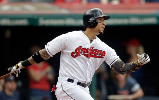 Cleveland Indians' Carlos Gonzalez watches his ...