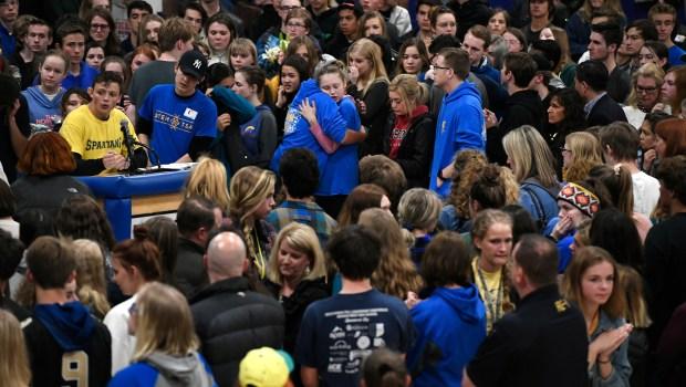 Students hug after gathering back in ...