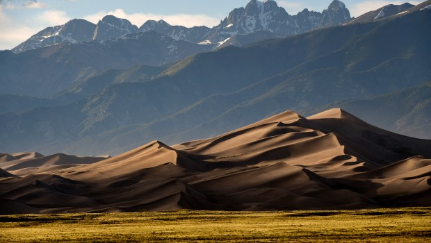 The Great Sand Dunes are lit ...