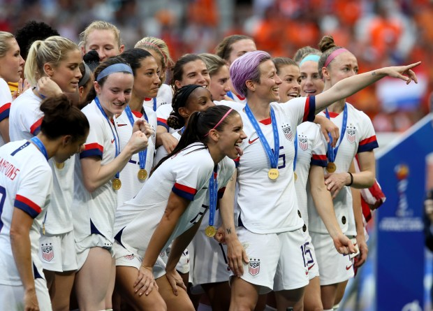United States' Megan Rapinoe, center, celebrates ...
