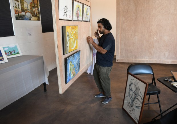 Artist Constance Earles, left, guides Lorenzo ...